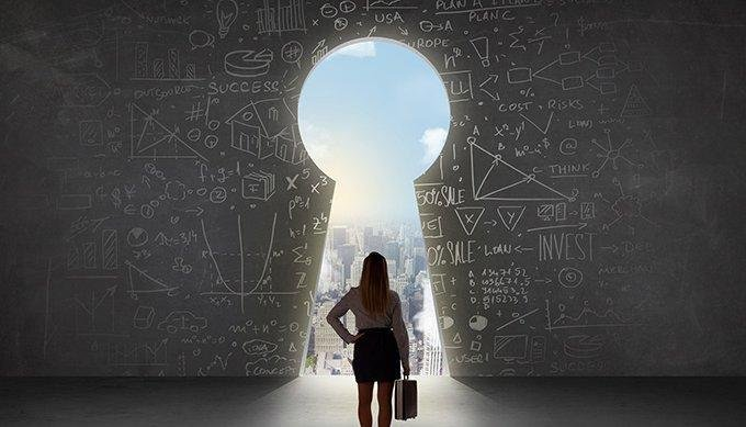 A woman stands in front of a key hole overlooking a cityscape full of new opportunities