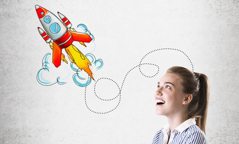 Business lady standing near concrete wall with rocket sketch on it. Concept of imagination and planning
