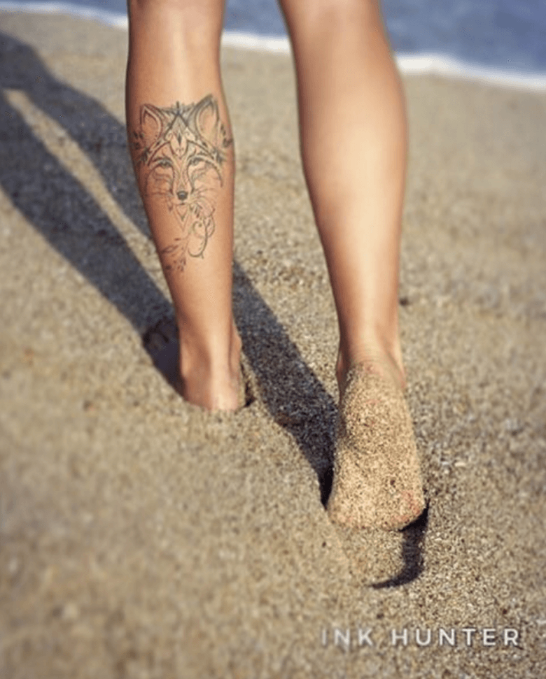 ink hunter, founders, tattoo, app, startup, Ukraine, entrepreneurs, young entrepreneurs, wolf tattoo, sand, beach, legs