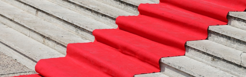 long staircase with a red carpet to welcome VIPs